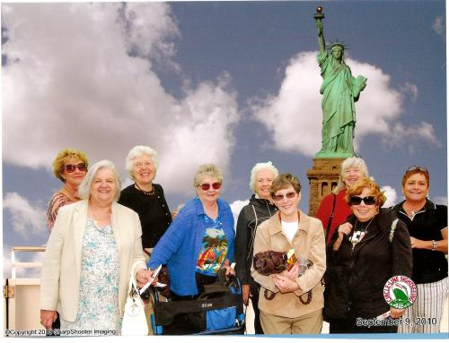 group with Statue of Liberty in background